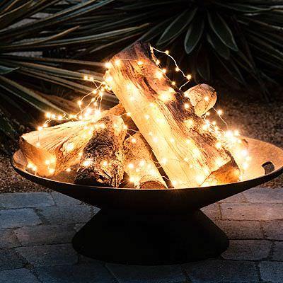Brasero fonte avec idee de buches illuminees par des guirlandes led