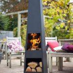 Brasero terrasse forme cheminee gris tres design avec rangement bois