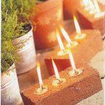 Eclairage naturel exterieur bougeoir dans brique avec bougies