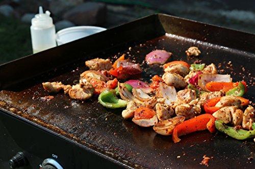 Grande plancha table poelee legume et viande grillee