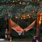 Lumiere exterieur guirlande ampoule dans arbre au dessus d un hamac esprit farniente